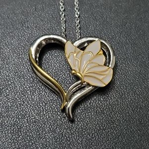 Silver tone butterfly on a heart pendant necklace
